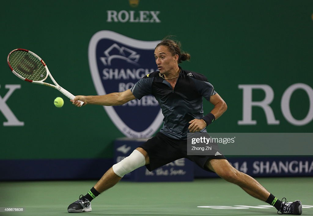 Alexandr Dogopolov of Ukraine returns a shot during his match against Roberto Bautista Agut of Spain during the day one of the Shanghai Rolex Masters at the Qi Zhong Tennis Center on October 5, 2014 in Shanghai, China.