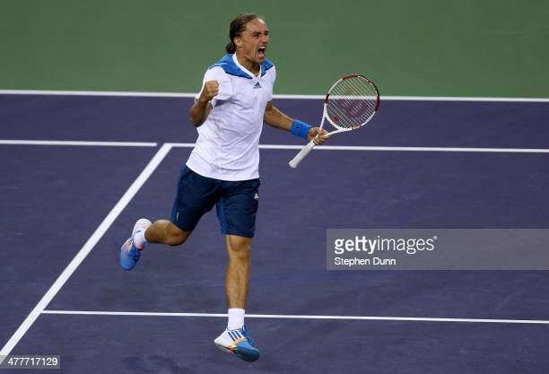 Alexandr Dolgopolov of The Ukraine celebrates after winning match point against Rafael Nadal of Spain during the BNP Paribas Open at Indian Wells...