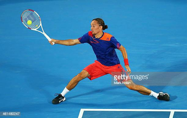 Alexandr Dolgopolov of the Ukraine plays a forehand in his match against Bernard Tomic of Australia during day five of the 2014 Sydney International...