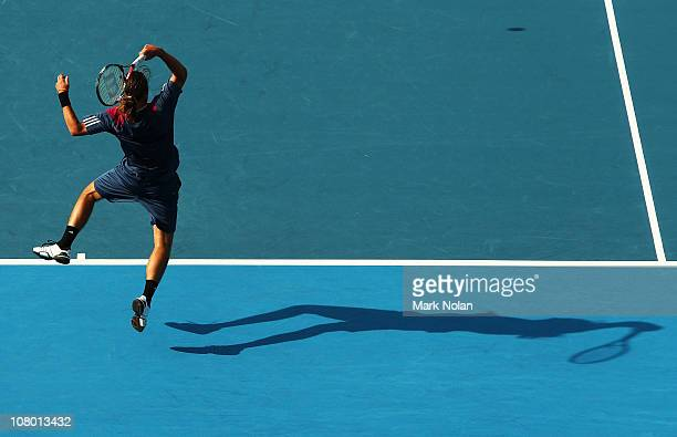 Alexandr Dolgopolov of the Ukraine plays a forehand in the match against Sam Querrey of the USA during day four of the 2011 Medibank International at...