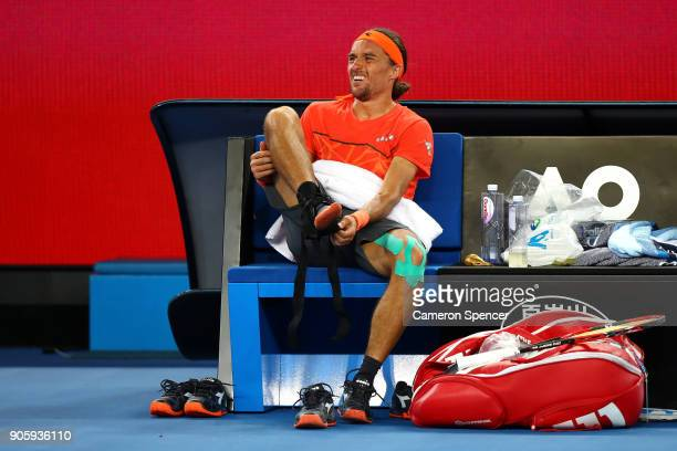Alexandr Dolgopolov of the UkraineÊchanges his shoes in his second round match against Matthew Ebden of Australia on day three of the 2018 Australian...
