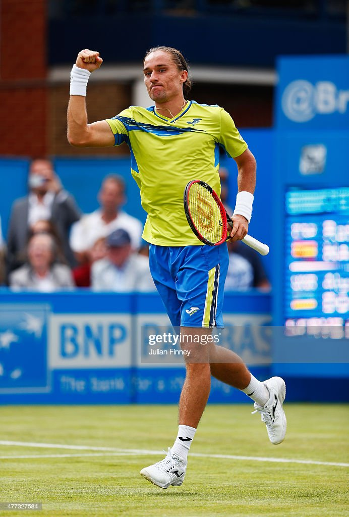 Alexandr Dolgopolov of Ukraine celebrates his victory in his men's singles first round match against Rafael Nadal of Spain during day two of the Aegon Championships at Queen's Club on June 16, 2015 in London, England.