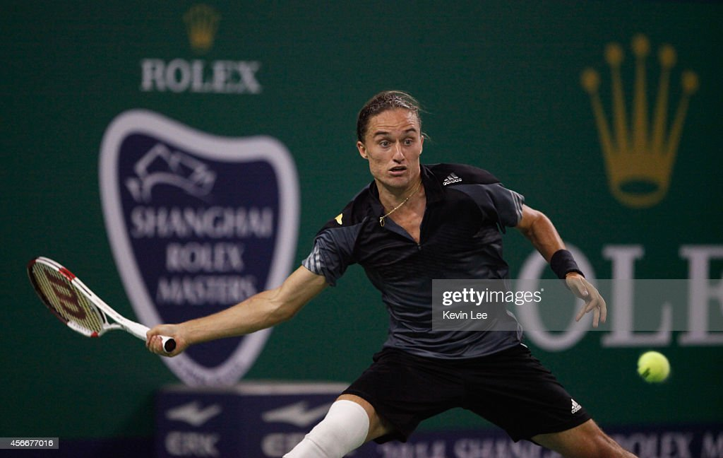 Alexandr Dolgopolov of Ukraine plays a forehand against Roberto Bautista Agut of Spain during his match at day 1 of the Shanghai Rolex Masters at Zi Zhong stadium on October 5, 2014 in Shanghai, China.