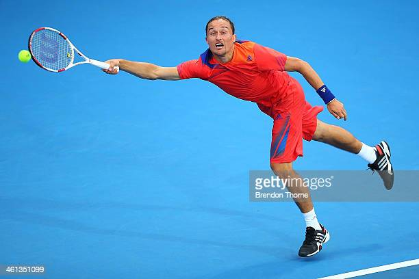 Alexandr Dolgopolov of Ukraine receives serve in his second round match against Jerzy Janowicz of Poland during day four of the 2014 Sydney...