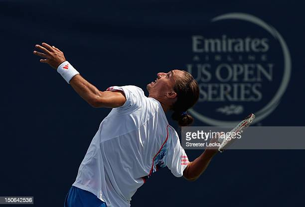 Alexandr Dolgopolov of Ukraine serves to Sam Querrey of the USA during the quarterfinals of the Winston-Salem Open at Wake Forest University on...