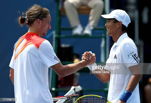 Alexandr Dolgopolov of Ukraine shakes hands with Yen-Hsun Lu of Chinese Taipei after defeating him in the quarterfinals during day 5 of the...