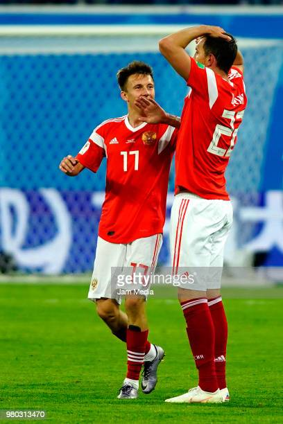 Alexandr Golovin of Russia celebrates with Artem Dzyuba of Russia after scoring his team's second goal during the 2018 FIFA World Cup Russia group A...