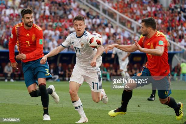 Alexandr Golovin of Russia competes for the ball with Nacho of Spain during the 2018 FIFA World Cup Russia Round of 16 match between Spain and Russia...