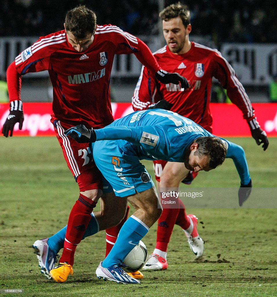 Alexandr Kerzhakov of FC Zenit St. Petersburg (C) vies for the ball with Akaki Khubutia (L) and Tomislav Dujmovic (R) of FC Mordovia Saransk during the Russian Football League Championship match between FC Zenit St. Petersburg and FC Mordovia Saransk at the Petrovsky Stadium on March 17, 2013 in St. Petersburg, Russia.