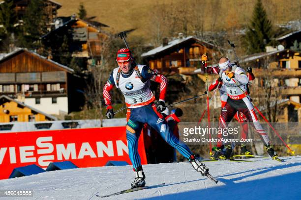Alexandr Loginov of Russia takes 1st place during the IBU Biathlon World Cup Men's Relay on December 13, 2013 in Annecy-Le Grand Bornand, France.