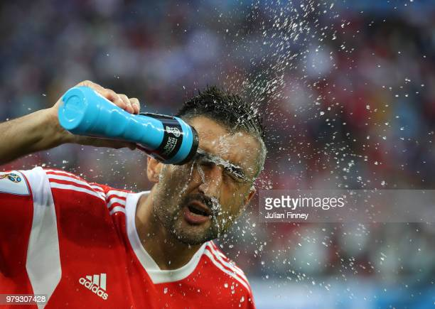 Alexandr Samedov of Russia sprays water over his face before the 2018 FIFA World Cup Russia group A match between Russia and Egypt at Saint...