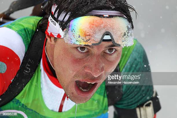 Alexandr Syman of Belarus competes in the men's biathlon 10 km sprint final on day 3 of the 2010 Winter Olympics at Whistler Olympic Park Biathlon...