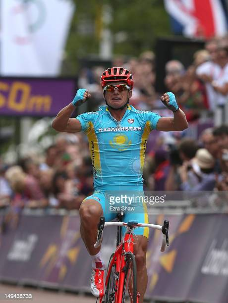 Alexandr Vinokurov of Kazakhstan celebrates crossing the finish line to win the Men's Road Race Road Cycling on day 1 of the London 2012 Olympic...