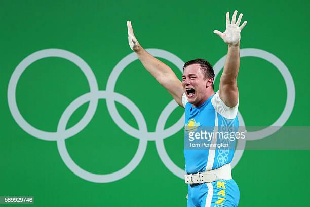 Alexandr Zaichikov of Kazakhstan reacts after lifting during the Men's 105kg Group A Weightlifting contest on Day 10 of the Rio 2016 Olympic Games at...