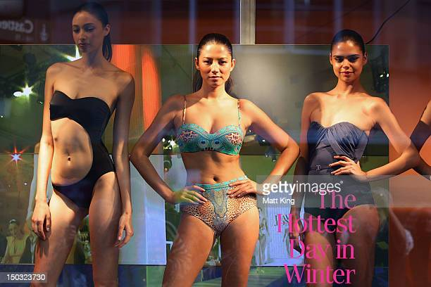 Alexandra Agoston Jessica Gomes and Samantha Harris showcase swimwear designs at the David Jones Elizabeth Street Store on August 16 2012 in Sydney...