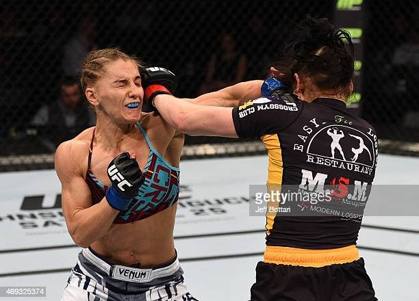 Alexandra Albu of Russia and Izabela Badurek of Poland trade punches in their women's strawweight fight during the UFC Fight Night event at the...