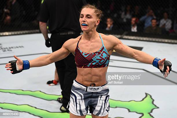 Alexandra Albu of Russia celebrates after her submission victory over Izabela Badurek of Poland in their women's strawweight fight during the UFC...