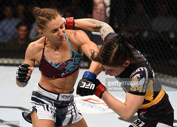 Alexandra Albu of Russia punches Izabela Badurek of Poland in their women's strawweight fight during the UFC Fight Night event at the Tauron Arena on...