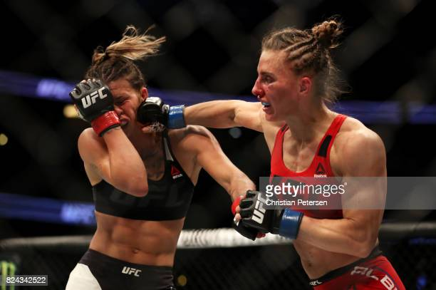 Alexandra Albu of Russia punches Kailin Curran in their women's strawweight bout during the UFC 214 event at Honda Center on July 29 2017 in Anaheim...