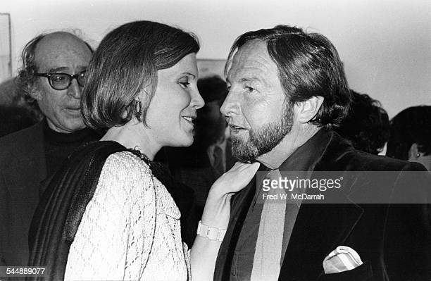 Alexandra Anderson arts editor at the Village Voice talks with Pop artist Robert Rauschenberg at a MOMA exhibit New York New York March 23 1977