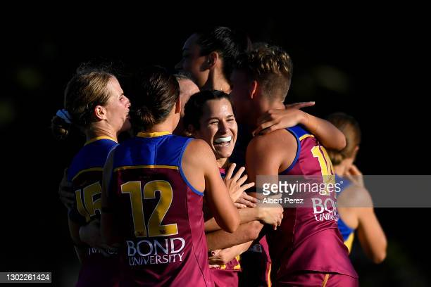 Alexandra Anderson of the Lions celebrates with team mates during the round three AFLW match between the Brisbane Lions and the West Coast Eagles at...