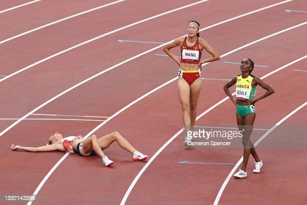 Alexandra Bell of Team Great Britain, Chunyu Wang of Team China and Natoya Goule of Team Jamaica react after competing in the Women's 800m Final on...