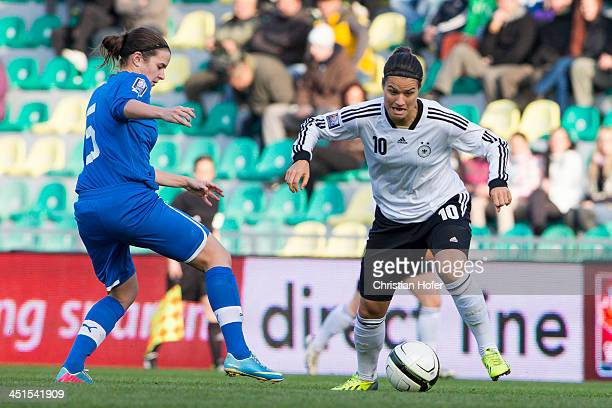 Alexandra Biroova of Slovakia competes for the ball with Dzsenifer Maroszan of Germany during the FIFA Women's World Cup 2015 Qualifier between...
