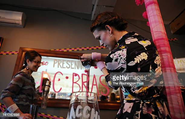 Alexandra Bookless L and Katie Nelson help build one big pisco sour drink as members of the national LUPEC combine their pisco sour mixes into one...