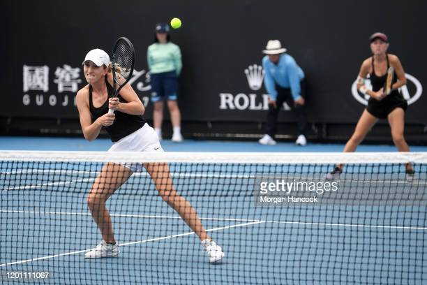 Alexandra Bozovic and Amber Marshall of Australia play during their Women's Doubles first round match against Aliaksandra Sasnovich of Belarus and...
