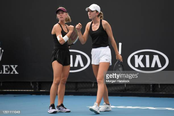 Alexandra Bozovic and Amber Marshall of Australia talk tactics during their Women's Doubles first round match against Aliaksandra Sasnovich of...