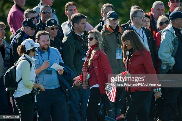 Alexandra Browne and Melissa Lehman follow the players during the session four singles matches at the 38th Ryder Cup at the Twenty Ten Course at...