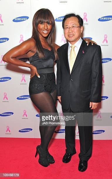 Alexandra Burke and Mr Sang Heung Shin attend The Samsung Pink Ribbon Celebration which raises awareness of and funds for breast cancer at The Royal...