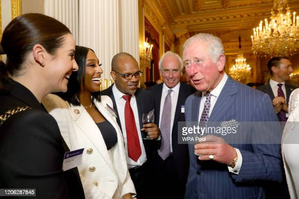 Alexandra Burke and Prince Charles Prince of Wales attend the Commonwealth Day reception 2020 on March 9 2020 in London England