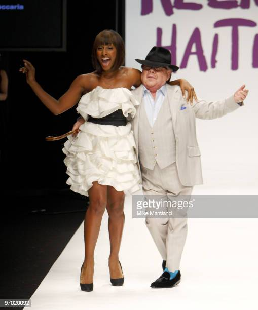 Alexandra Burke and Ronnie Corbett walk the runway at the Fashion for Relief show for London Fashion Week Autumn/Winter 2010 at Somerset House on...