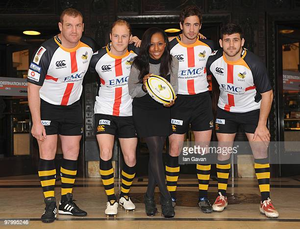 Alexandra Burke attends a photocall with Tim Payne Joe Simpson Danni Cipriani and Rob Webber from the London Wasps Rugby Union team at Selfridges on...
