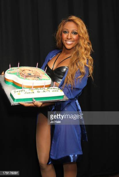 Alexandra Burke poses backstage with her Birthday Cake at GAY on August 31 2013 in London England