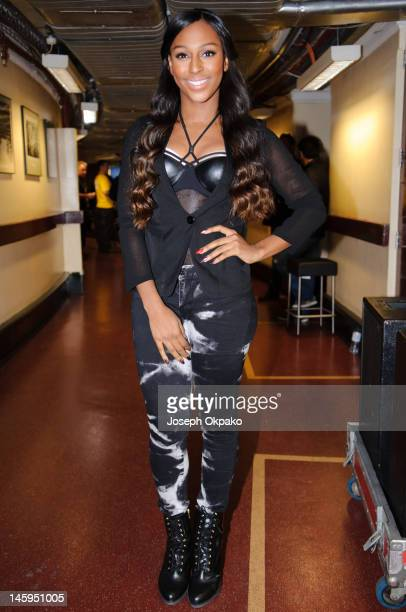 Alexandra Burke poses for a picture backstage before performing on stage at the Rays of Sunshine Concert at Royal Albert Hall on June 7, 2012 in...