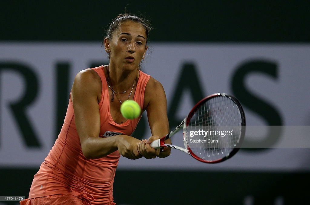 Alexandra Cadantu of Romania hits a return to Coco Vandeweghe during the BNP Paribas Open at Indian Wells Tennis Garden on March 6, 2014 in Indian Wells, California.