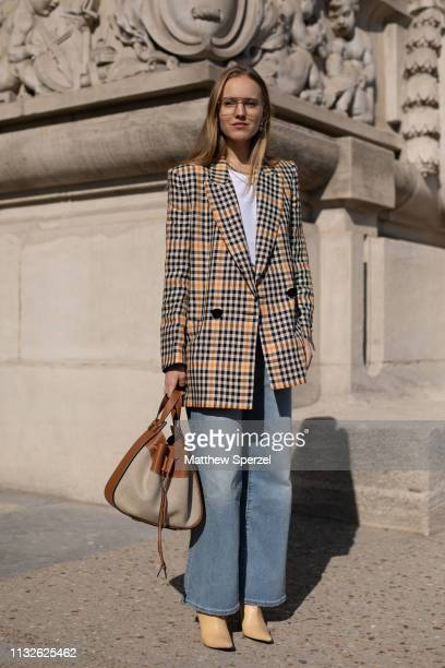 Alexandra Carl is seen on the street attending MAISON MARGIELA during Paris Fashion Week AW19 wearing MAISON MARGIELA blazer with blue jeans on...