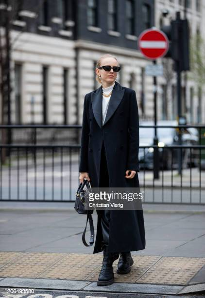 Alexandra Carl is seen wearing black coat and bag outside Petar Petrov during London Fashion Week February 2020 on February 15 2020 in London England