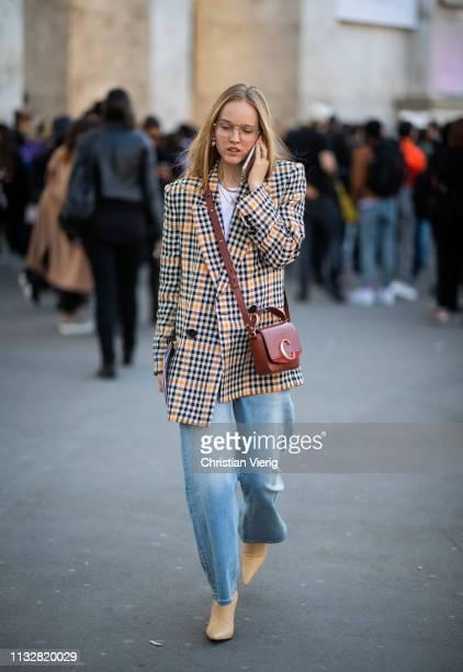 Alexandra Carl is seen wearing plaid blazer Chloe bag denim jeans outside Dries van Noten during Paris Fashion Week Womenswear Fall/Winter 2019/2020...