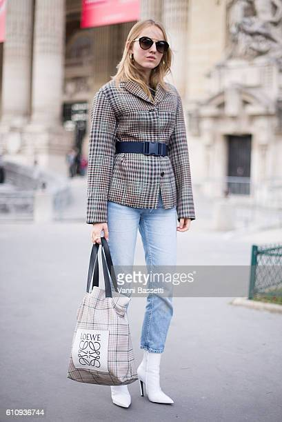 Alexandra Carl poses with a Loewe tote bag after the Maison Martin Margiela show at the Grand Palais during Paris Fashion Week Womenswear SS17 on...