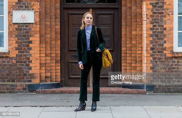 Alexandra Carl wearing a green velvet suit and yellow Chloe Lexa bag outside of JW Anderson during London Fashion Week Spring/Summer collections 2017...