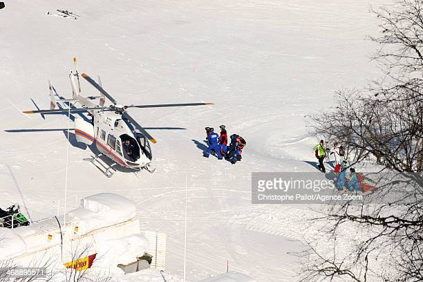 Alexandra Coletti of Monaco is helicoptered off after crashing during the Alpine Skiing Women's Downhill at the Sochi 2014 Winter Olympic Games at...