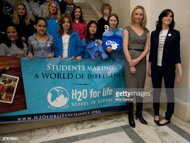 Alexandra Cousteau and Mandy Moore pose for a photo during a photo op in the Russell Senate Office Building the 2010 World Water Day coalition on...