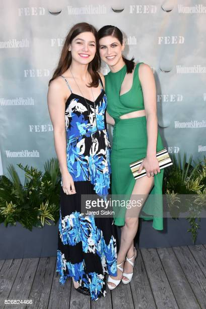 Alexandra Daddario and Catherine Daddario attend Women's Health and FEED's 6th Annual Party Under the Stars at Bridgehampton Tennis and Surf Club on...