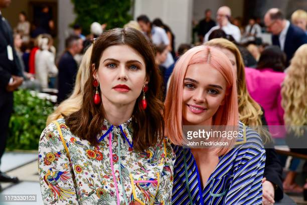 Alexandra Daddario and Charlotte Lawrence attend the Tory Burch S/S 20 Fashion Show at Brooklyn Museum on September 08 2019 in New York City