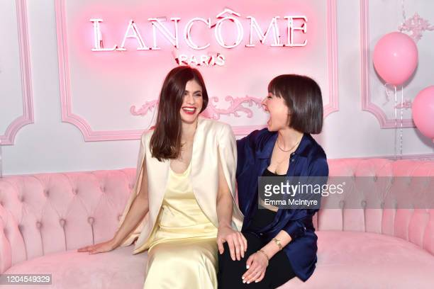 Alexandra Daddario and guest attend Vanity Fair and Lancôme Toast Women in Hollywood on February 06 2020 in Los Angeles California