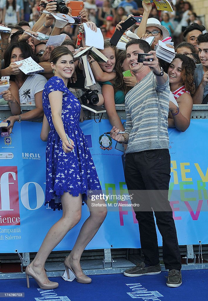 Alexandra Daddario and Logan Lerman attend 2013 Giffoni Film Festival blue carpet on July 23, 2013 in Giffoni Valle Piana, Italy.