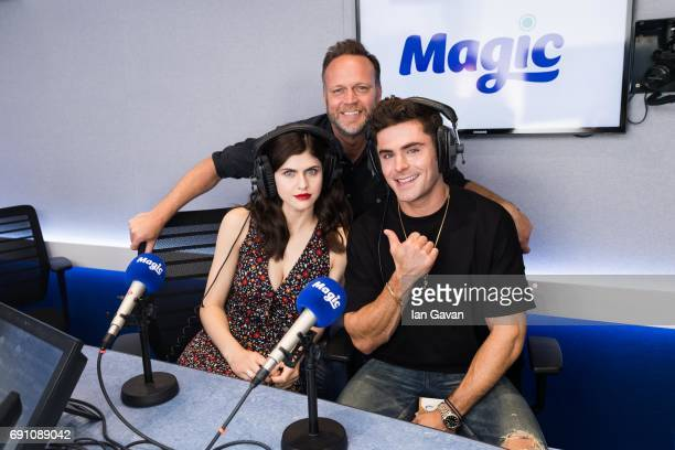 Alexandra Daddario and Zac Efron pose with Magic Radio Breakfast show host Nick Snaith at the Magic FM studio at Magic Radio on June 1 2017 in London...